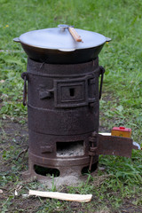 outdoor cast-iron stove with a bowler