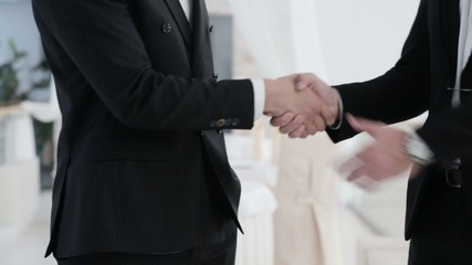 Handshake with both hands