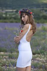 sad woman in a lavender field.