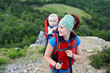 A young woman trekking with her baby
