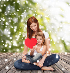 happy mother with adorable little girl and heart