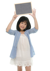Beautiful asian girl holding chalk board on white