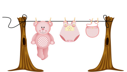 Baby girls clothing with teddy bear on clothesline