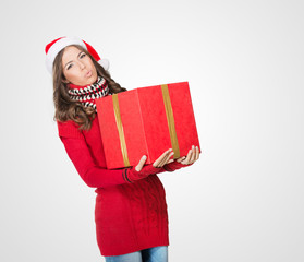 Beautiful woman carrying a large present