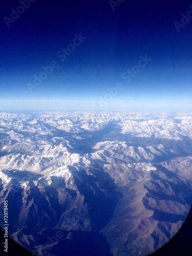 canvas print picture Alpen aus einem Flugzeugfenster