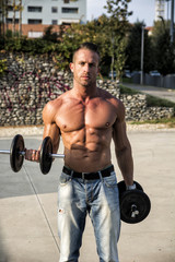 Shirtless Hunk Man Carrying Weights