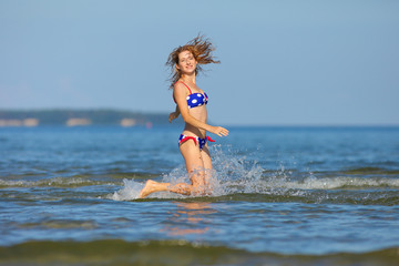 woman running in the water