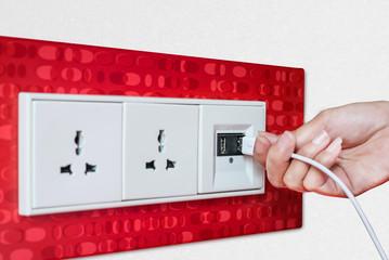 Woman hand plug USB Wall socket/outlet plate