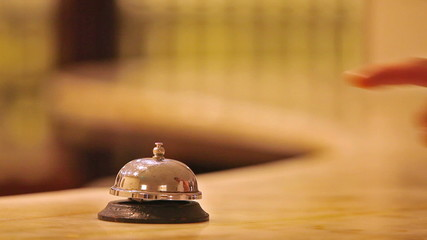 call at old hotel bell on a wood stand
