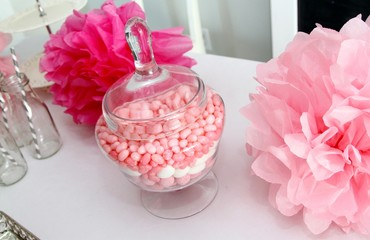 Pompoms, glass bottles and candies in a jar