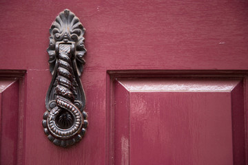 a decorative Victorian door knocker