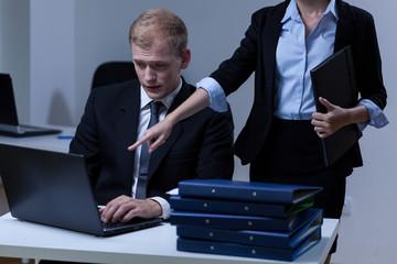 Boss commanding his worker