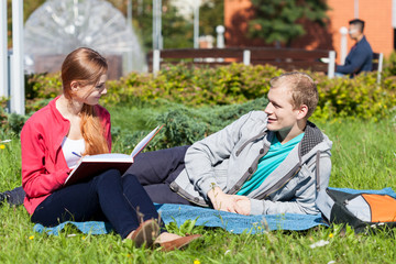 University friends sitting on the grass