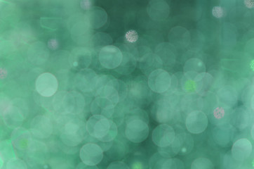 Abstract circular bokeh cold green background