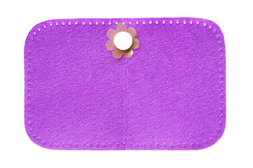plastic flower and  purple velvet cloth on white background