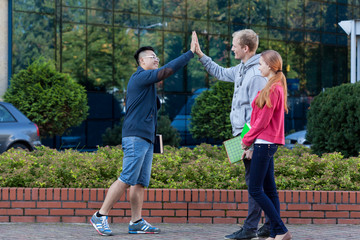 Asian young man giving friend five