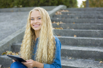 Beautiful girl with a tablet to chat online