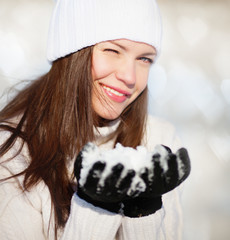 Girl playing with snow