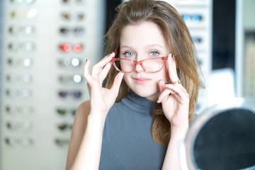 Beauty headshot of beautiful woman holding eyeglasses