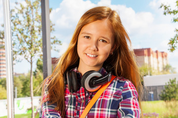 Portrait of young girl with headphones