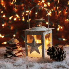 Lantern and christmas lights burning in dark