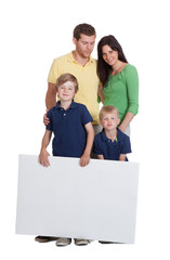 Happy Family Holding Blank Billboard