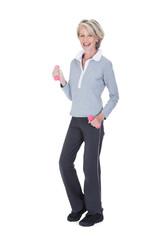 Portrait Of Happy Woman Lifting Dumbbells