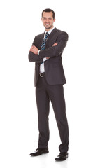 Confident Young Businessman Standing Arms Crossed