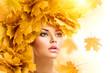 Leinwandbild Motiv Autumn woman with yellow leaves hairstyle. Fall. Creative makeup