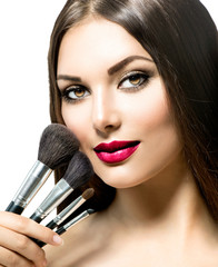 Beauty Woman with Makeup Brushes. Applying Holiday Makeup