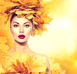 Autumn woman with yellow leaves hair style
