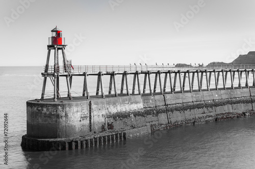 Scenic view of Whitby Pier in black and white, UK. - 72092644