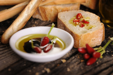 Small bowl of olive oil and balsamic vinegar with dipping bread