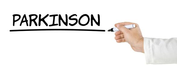 Hand mit Stift schreibt Parkinson