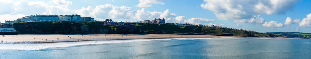 View of Whitby beach in a sunny day in North Yorkshire, UK