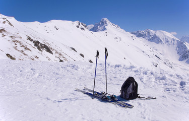Skis, ski poles, backpack and Giewont in Tatras