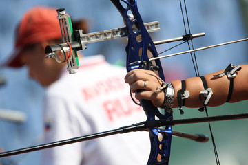 Bow and arrow in the hands of an archer