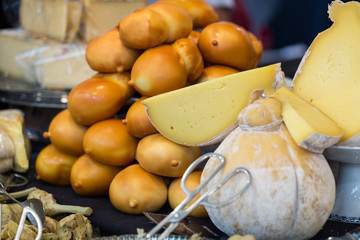 Various types of cheese on market stall
