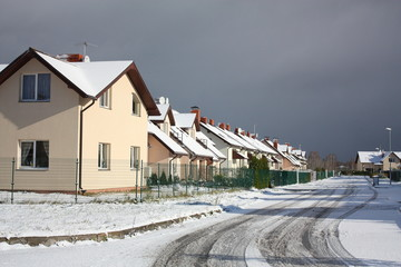 View on street with cottages in winter