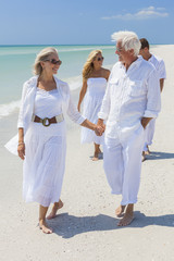 Four People Two Senior Family Couple Walking Tropical Beach
