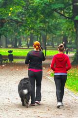 Two teenage with dog