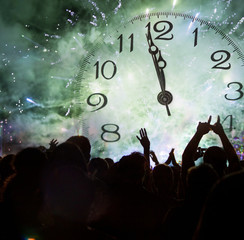 Clock close to midnight, and crowd waiting for New year