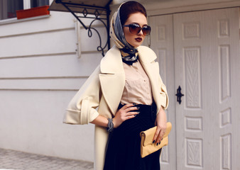 beautiful woman in elegant coat with accessories