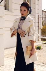 elegant ladylike woman in white coat with accessories
