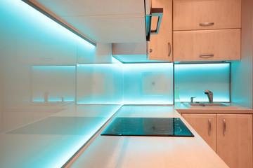 Modern luxury kitchen with blue LED lighting