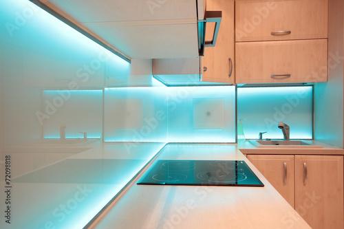 Modern luxury kitchen with blue LED lighting - 72098818
