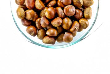 chestnuts in a bowl with empty space on the right are pieces in