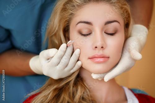 Fototapeta Woman receiving cosmetic injections
