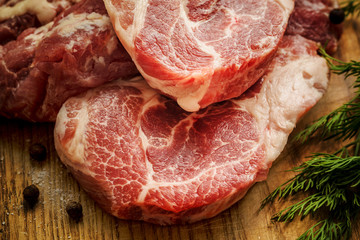 Raw Fresh Meat Slices on Wooden Chopping Board