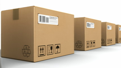 Moving row of cardboard boxes